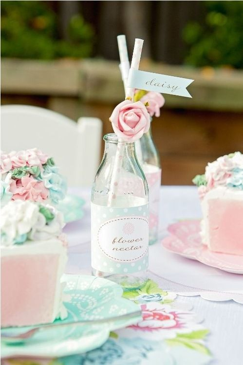 Pretty milk bottle and roses afternoon tea party setting