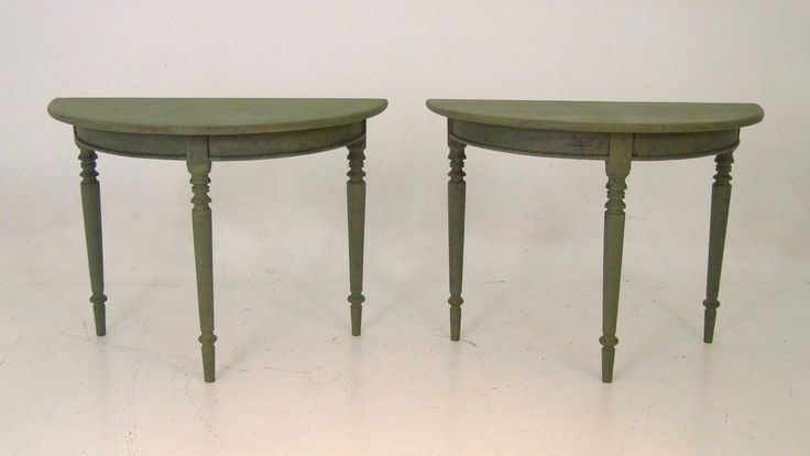 A pair of Swedish demi-lune tables, apx. 1830.  http://www.selected-antiques.dk/12348-1v-------a-pair-of-swedish-demi-lune-tables-apx-1830