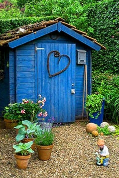 Blue garden shed with twig heart