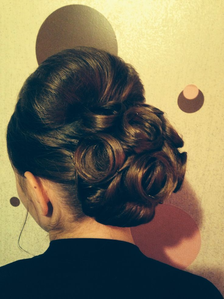 Bun with poof and pin curls
