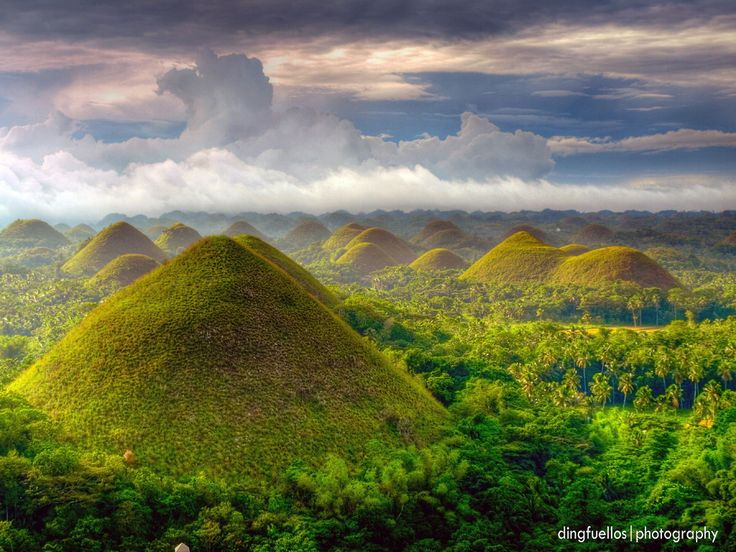Chocolate Hills, Bohol, Philippines - I believe that this is nature at it's finest. The beauty of the hills and how the clouds almost seem to touch the hills. It's as if you climbed up the hill you would be able to touch the clouds