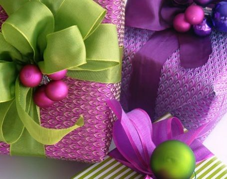 Brightly colored gift wrap with ornaments. So pretty!