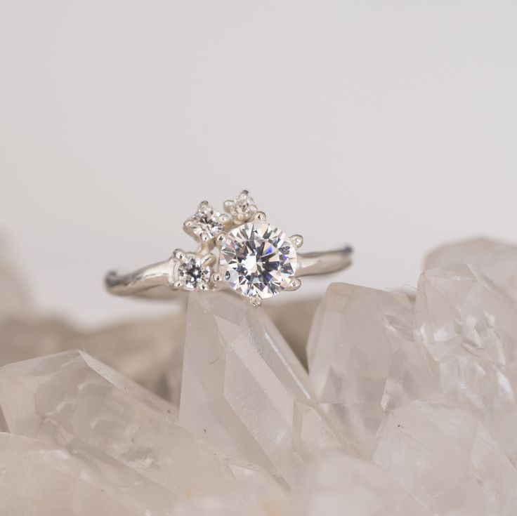 diamond cluster with 1ct diamond. Made from white gold to order. Amazing engagement ring.