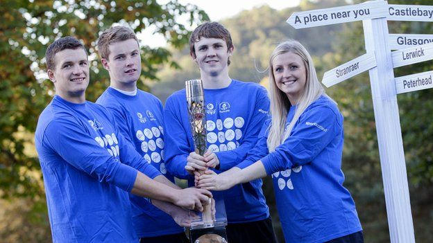 Scottish athletes Russell Weir, Marc Austin, Ross Murdoch and Beverly Campbell clutch the baton in Stirling before it journeys to India