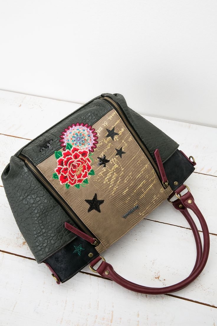 The bag is as sturdy as it is beautiful so it will get you through this turbulent season. The muted olive, charcoal and fawn colors come to life with the caligraphy and bright floral patches.