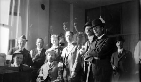 Group of men drinking beer, 1912. (Photo by James Luke Quiney, via Vancouver Archives)