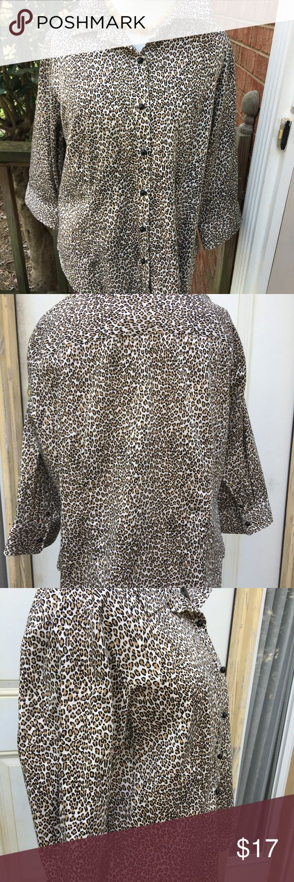 NWOT Talbots's Leopard Top This brand new top is a rich leopard print. 98% cotton; 2% Lycra spandex for a bit of stretch.adorable brown ball buttons. 3/4 sleeves with 2 buttons on each sleeve. You will look polished and put-together in this lovely top. Pristine condition. Talbots Tops Blouses