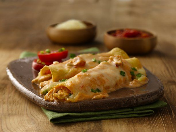These cheesy chicken enchiladas are super easy and only have a few ingredients. They're delicious.