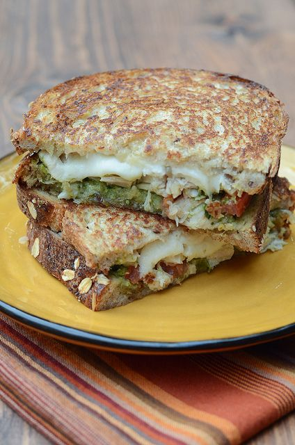 Turkey Pesto Grilled Cheese Sandwiches with fresh Mozzarella, pesto & tomatoes via From Valerie's Kitchen. Looks like a true winner of a left-over turkey recipe! #Thanksgivingleftovers