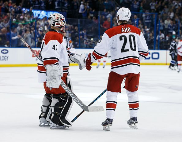 TAMPA, FL - DECEMBER 31: Emergency backup goalie Jorge Alves #40 of the Carolina Hurricanes is congratulated on his NHL debut by teammate Sebastian Aho #20 during third period against the Tampa Bay Lightning at Amalie Arena on December 31, 2016 in Tampa, Florida. (Photo by Scott Audette/NHLI via Getty Images)