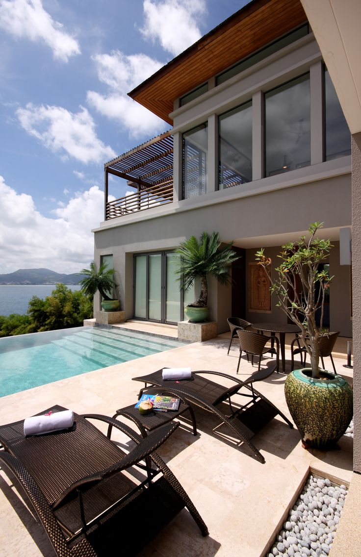 We love how the door leads right into the pool and the overlooking patio above. It gives you a great view to the pool and the ocean. See 7 ways to make your patio awesome by clicking on the pin! #patios #oceanview