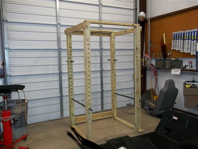 Homemade power rack made out of wood and pipe home gym
