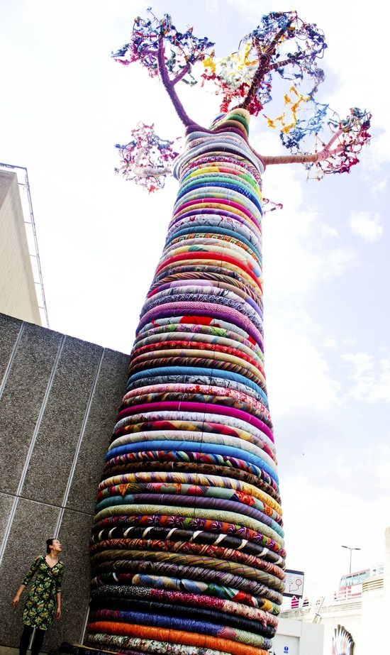 15 metre tall baobab tree sculpture in Southbank, London as part of the Festival of the World exhibition. Each ring is made by people and material from around the globe. The baobab tree is the oldest living tree in Africa, a symbol for meditation and community. #textileart