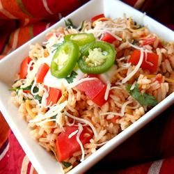 Mexican Rice III Allrecipes.com... I like to try this one just add more cheese!