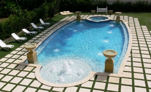 Pool with led fountain bubblers on tanning ledge led deck for Swimming pool water features