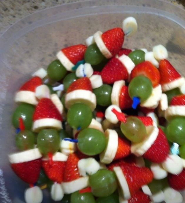 GRINCH KABOBS! Mini marshmallow, strawberry, banana slice & grape on a toothpick.