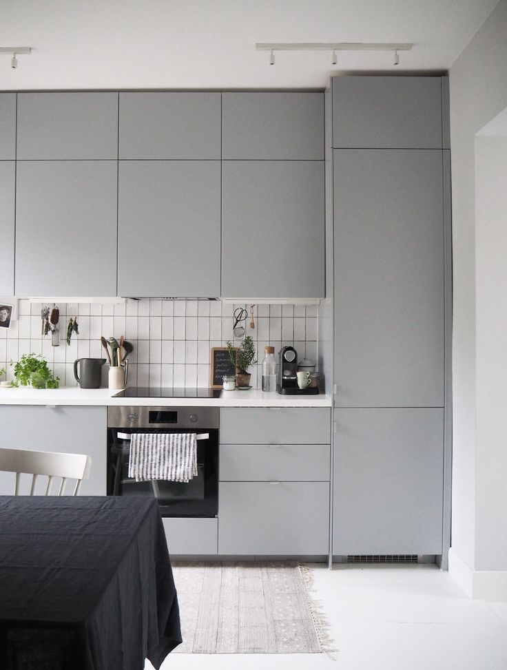 Sleek grey and white IKEA kitchen makeover before and after - lots of inspiration for small homes