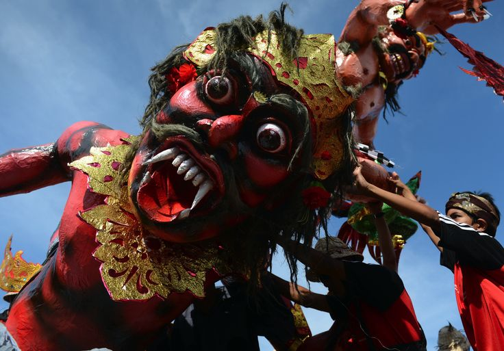 """Indonesia's minority Hindu devotees parade their 'Ogoh Ogoh' effigies during a ceremony at Jakarta's central National Monument on March 11, 2013 on the eve of Nyepi or Day of Silence."""