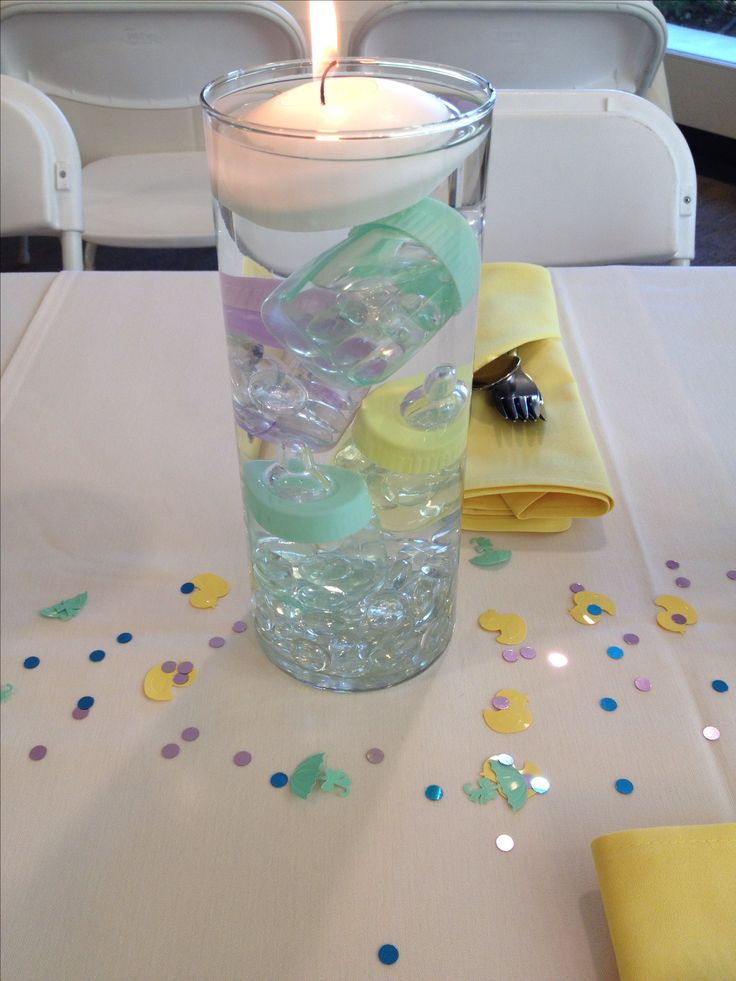 Baby shower centerpiece. Gender neutral. Baby bottles and floating candles!