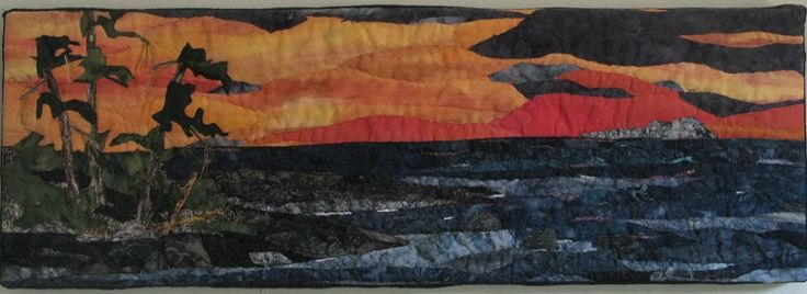 Sunset on the Bay.  #Landscape quilt, designed by Chris Allaway.  Fabric collage, free motion sewing, mounted on canvas. 30 x 10. sold