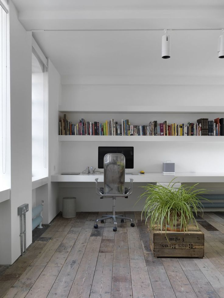 Many wonderful aspect to this workspace including flooring, space, plant, windows.