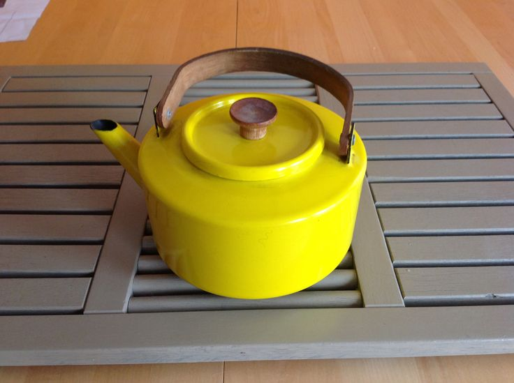 Vintage bright yellow Spanish tea pot, with wooden handle.