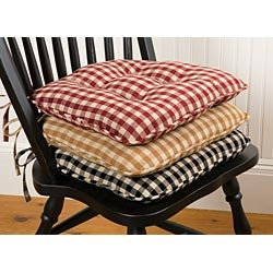 Maybe a DIY seat cushion project for the wooden dining table chairs? Diff fabric..