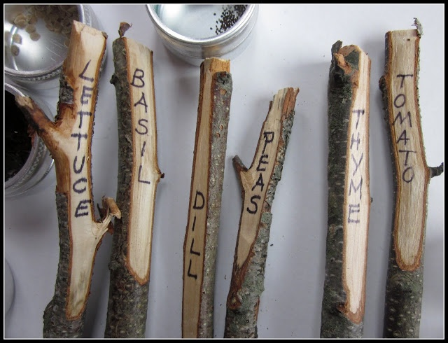 Whittle a few sticks, use Sharpie permanent pen and wha-la ... all natural vegetable markers for the garden! :)