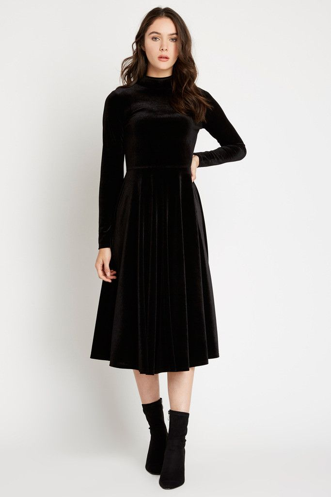 Details Arrive in elegance in this all-over velvet number. This dress features long, fitted sleeves and a midi length swinging skirt. A mock neckline completes this classic look with a two-button keyh