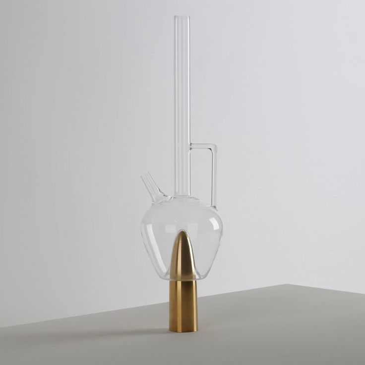Beirut designer Richard Yasmine has created a collection of glass vessels that rest on dildo-like brass objects.