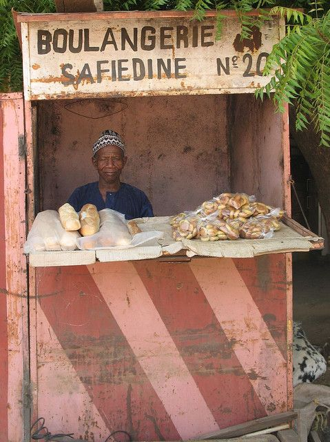 Many street vendors set up stands along highways or in marketplaces to sell their products.  In West Africa, BREAD STANDS are a common sight. There are quite a number of breads available in West Africa. TAPALAPA is a baguette-style bread is sold in loaves.  It is made from a mixture of wheat and millet flour, maize flour, and cowpea (niébé) flour. SENFUR (or sen fur) is very similar to the taste and texture of a baguette, though shorter and a bit less crunchy than the French bread. PAIN AU…