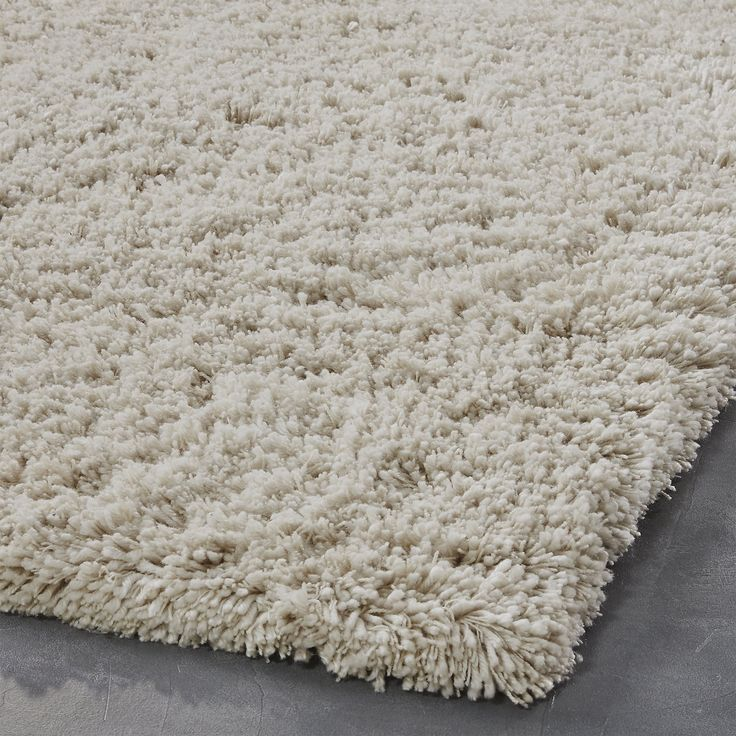 Shop puli natural shag rug 5'x8'.   Lightly luminescent yarn varies in thickness and height creating an uneven pile that's extra plush to the touch and pleasing to the eye.