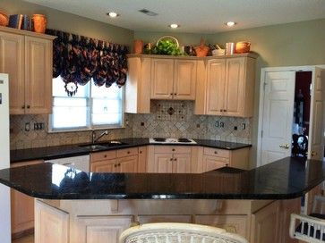peacock kitchen decor | peacock granite on light wood kitchen