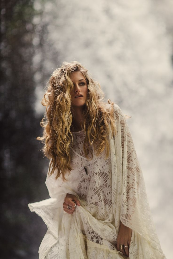 Bohemian white lace kaftan and wild curly hair