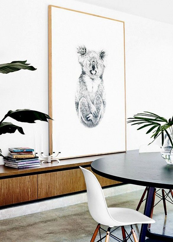 Dining space with oversized koala art print.