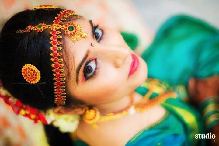 South Indian bride. Temple jewelry. Jhumkis.Green silk kanchipuram sari.Braid with fresh jasmine flowers. Tamil bride. Telugu bride. Kannada bride. Hindu bride. Malayalee bride.Kerala bride.South Indian wedding
