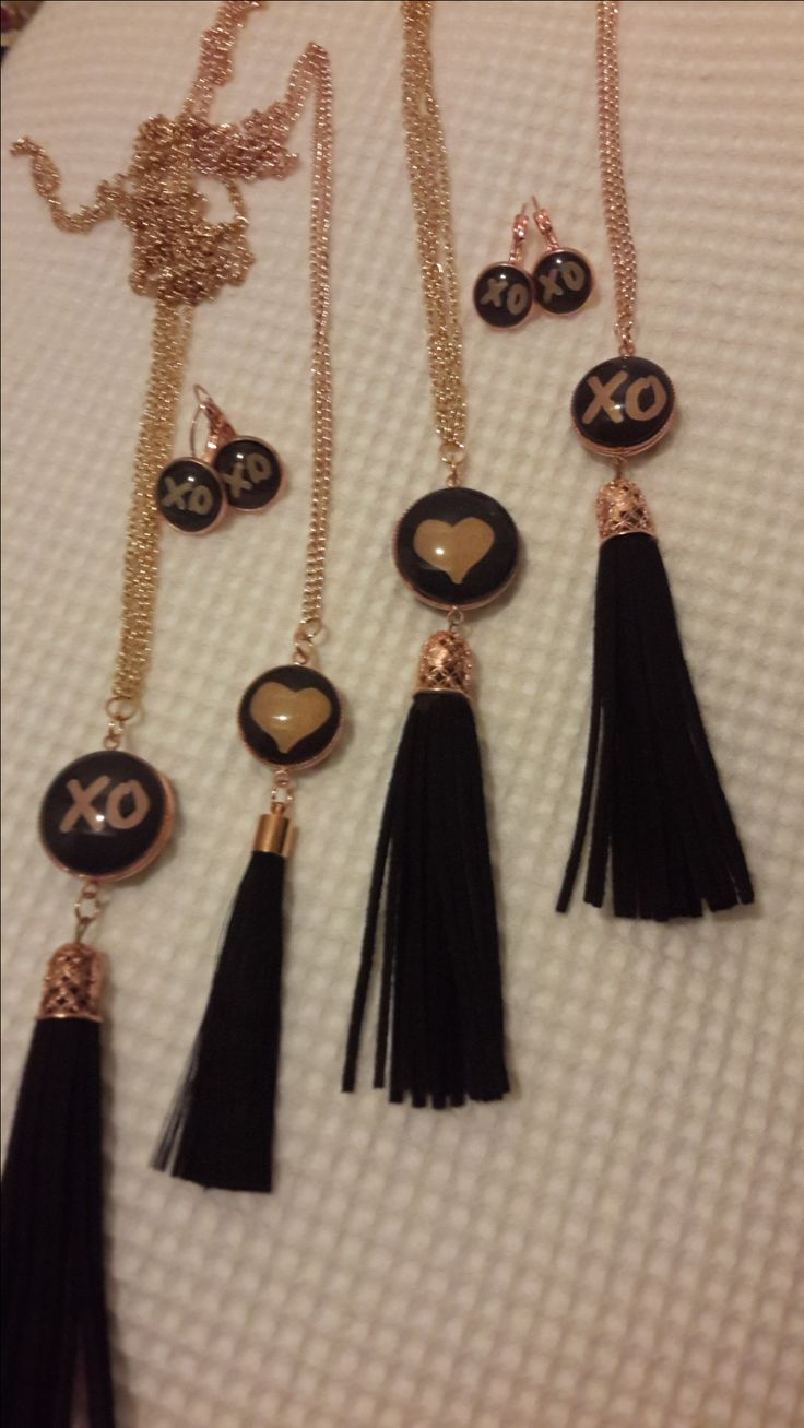 Reversable XO pendant with tassels XO on one side and a ♡on the other side Nice long chain