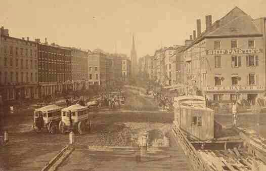 View of traffic on Wall Street in New York City, c. 1860's. Believed to be the earliest known photo of Wall Street.