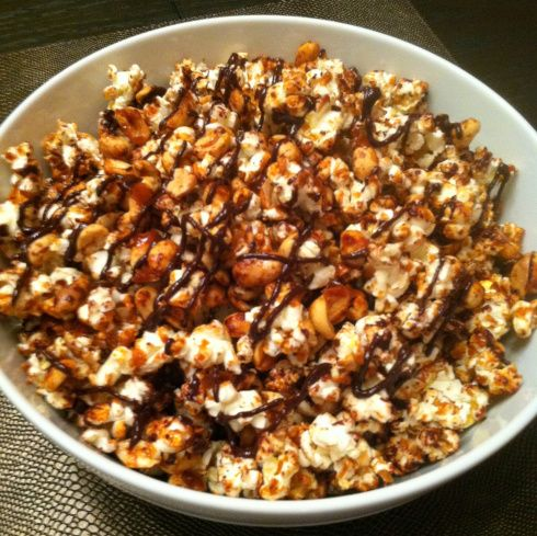 One of two things is likely to occur when you savor this Salted Caramel & Dark Chocolate Popcorn: 1) You will stop going to the movies and start watching every movie at home with a big bat...