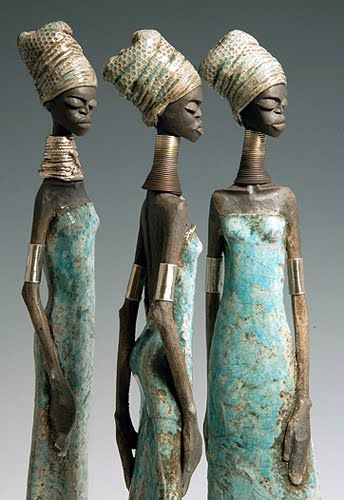 DAILY MUSE: Toni Foard,  describes himself as an English potter, hand builds each female figure using white clay. Each sculpture is fired several times in sections and they allhave a distinctively African feel to them. The color often comes from controlling the way the smoke penetrates the surfaces, in addition to glazes and lustres. His goal is for each slender figure to have 'attitude'.