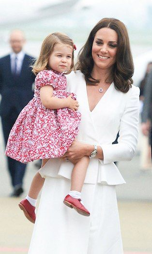 44e05bf42 Princess Charlotte during her family's tour of Poland and Germany in July  2017 wearing red and white floral dress with matching Mary-Jane red shoes  and ...