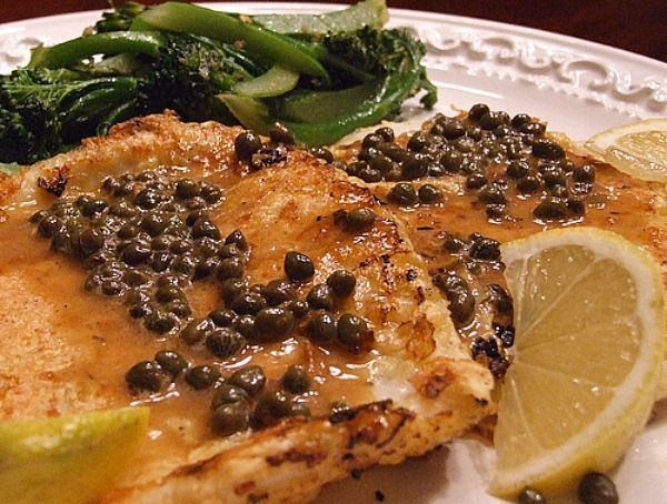 Lemon- Caper Calamari Steaks Recipe Main Dishes with olive oil, all-purpose flour, grated parmesan cheese, black pepper, large eggs, water, steak, unsalted butter, fresh lemon juice, capers, lemon