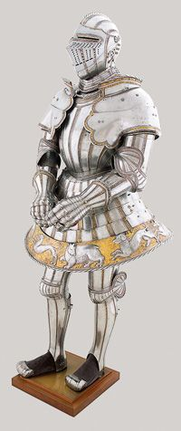 """Armor with a tonlet, or flaring skirt, was designed for combat on foot within an enclosed field, a tournament sport in which swordsmen were awarded points according to the quantity and location of the blows th, this ensemble has been known as the """"Hunt Tonlet"""" armor since the sixteenth century.   Kolman Helmschmid, German, c. 1470–1532, Armor of Emperor Charles V, Augsburg, c. 1525, etched and gilt steel, leather, Patrimonio Nacional, Real Armería, Madrid"""