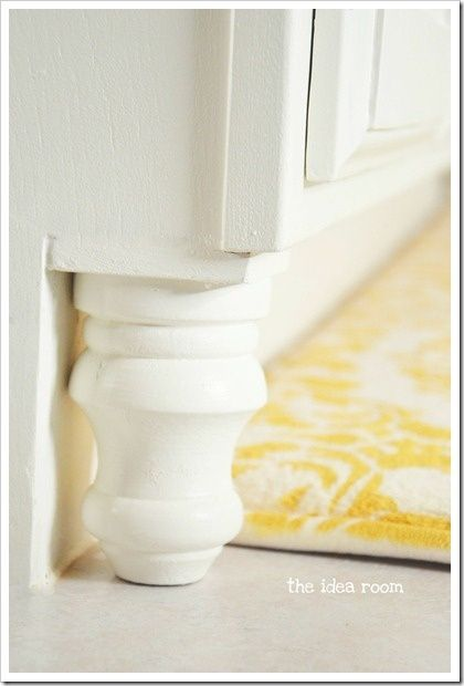 Add finial feet to builder grade cabinets. Easy DIY bathroom cabinet upgrade. There is a link to the yellow DIY bathmat, too! @ Pin Your Home
