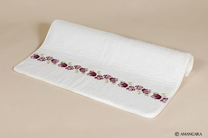 Dry your feet beneath a row of embroidered peonies.