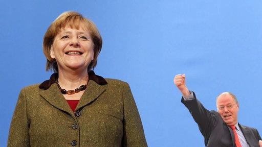 Angela Merkel und Peer Steinbrück (Montage)  Fotograf: [M]: Jens Koehler/Sebastian Pieknik/i