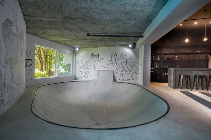 """The ultimate man cave! We converted the unused lounge area of a Cape Town residence into an industrial-inspired dream pad for the family's teenage boy and his friends. The design includes impressive design elements, such as a fully functional skate bowl, mammoth timber """"wave"""" and a four-and-a-half-metre bar!  #InhouseBrandArchitects #mancave #interiordesign"""