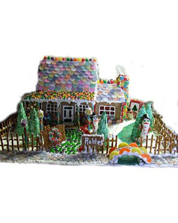 With ages raging from 10 to 39, ajodesertrat's family put together this country house that includes a snowman painting, a Necco roof, a patio made from Nerds, a pretzel fence, and Jolly Rancher stained-glass windows.