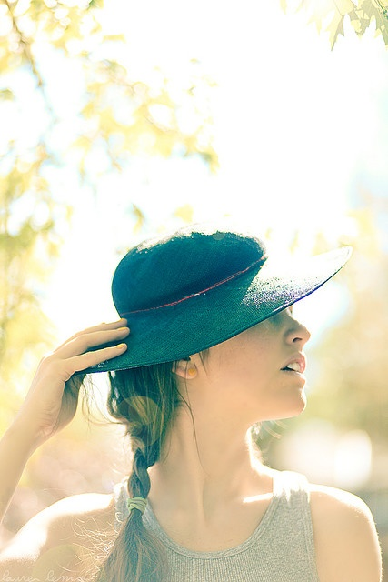 natural light photography.  Great rim lighting, love how they incorporated the hat with out causing harsh shadows.