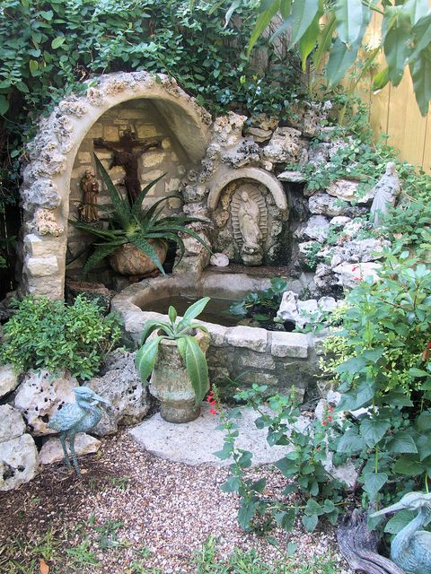 """Congratulations to Larry and Monica A., the winners of our 2012 Garden Contest! """"The Garden Grotto is found in the left hand corner of the back yard. Larry built the Grotto all by himself. My husband and I gave him the St Anthony statue as a thank you for all their kindness to us during my fight with cancer. Larry placed the St. Antony statue with his other treasures in his grotto. The Crucifix is an antique from France."""""""